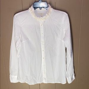Long sleeved white button up blouse/shirt